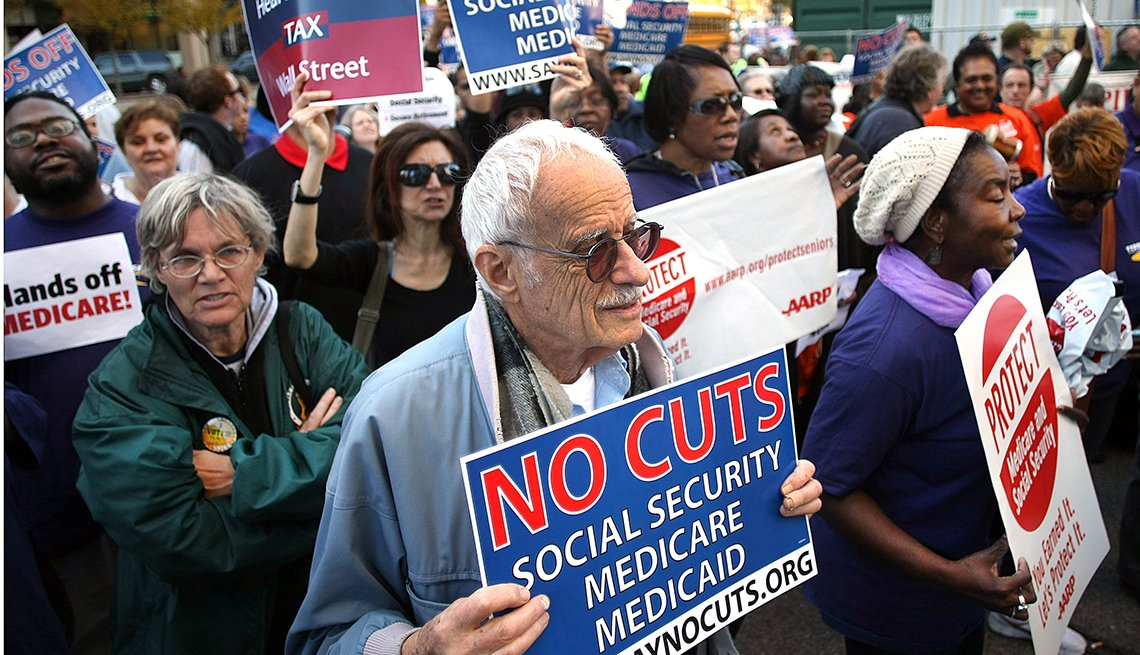 A group of people attend a rally about protecting Medicare, Medicaid and Social Security