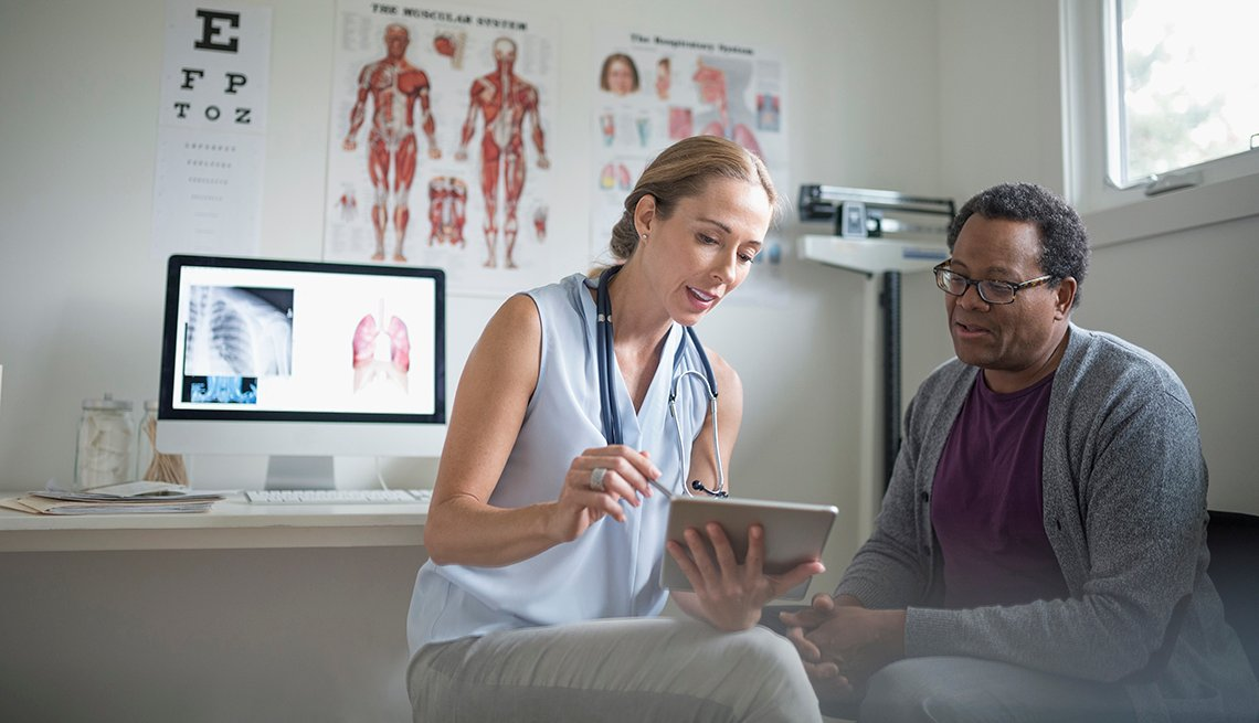 doctor and patient looking at a tablet