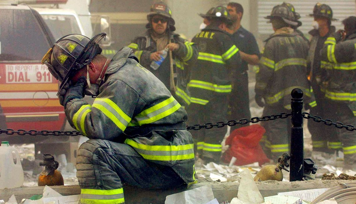 Firefighter breaks down after the September Eleventh terrorist attacks in New York City.