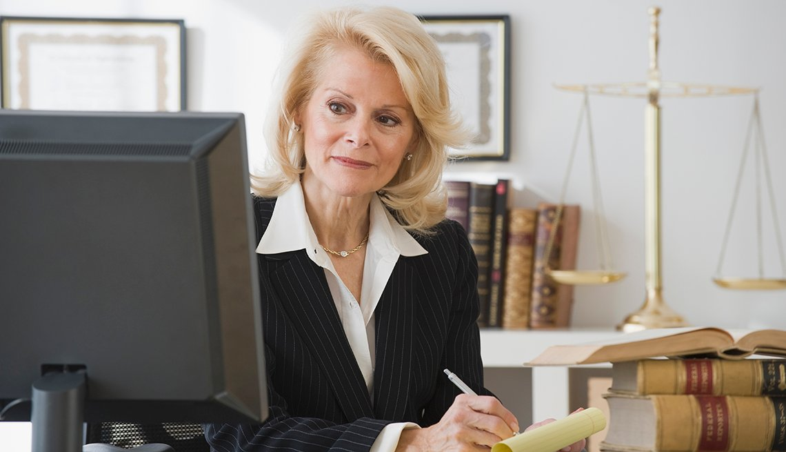 Lawyer working at a desk writing on paper