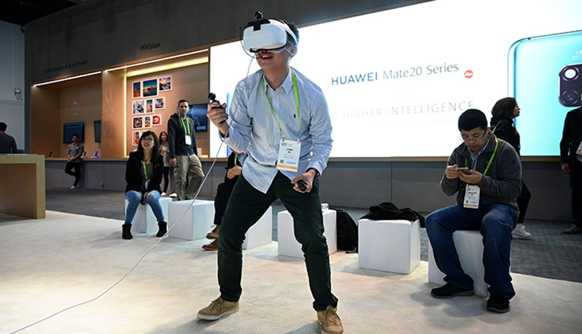 An attendee plays the Huawei VR2 virtual reality music game on the last day of CES 2019, on January 11, 2019 at the Las Vegas Convention Center in Las Vegas, Nevada. - The enormous international gadget and consumer electronics show returns to Las Vegas on