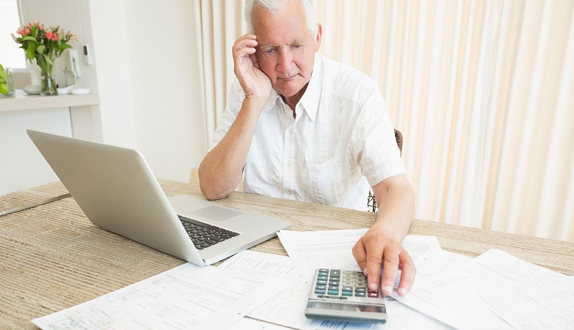Man looking at bills on his table