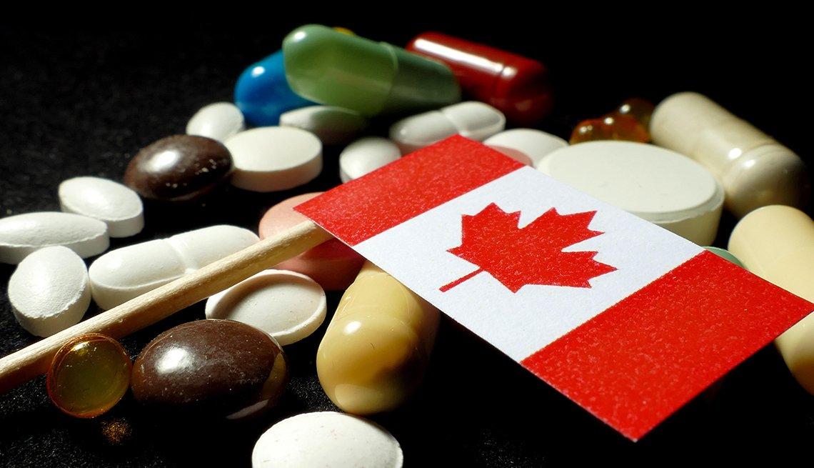 Bandera de Canadá junto a varias pastillas