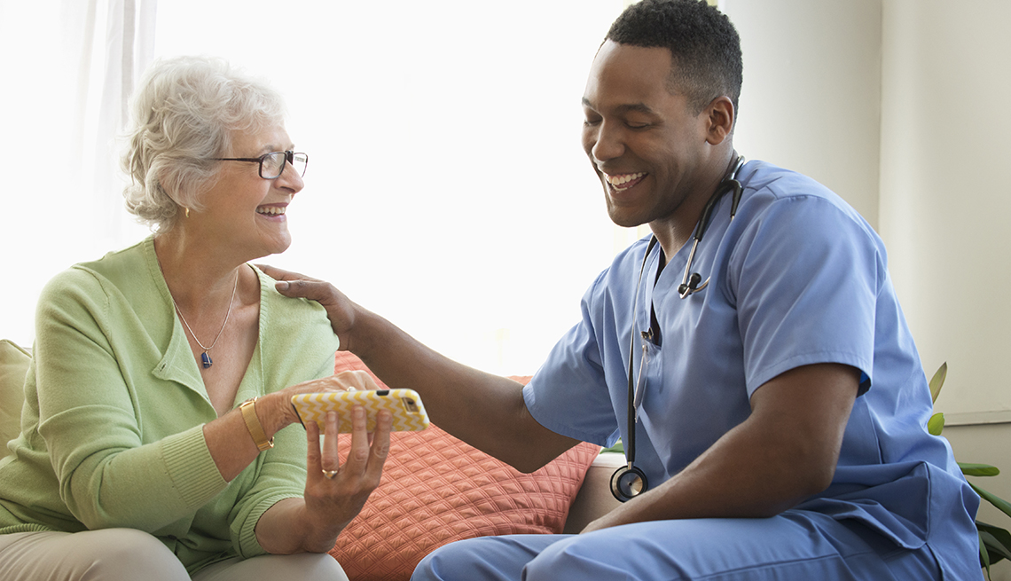 Male nurse talks with a patient