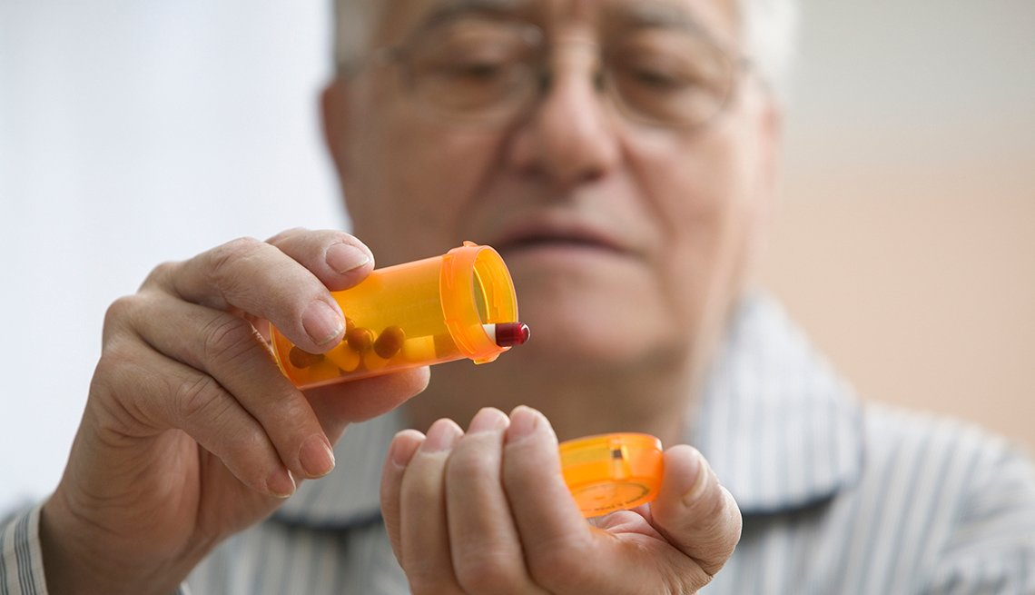 Older man getting ready to take his prescription