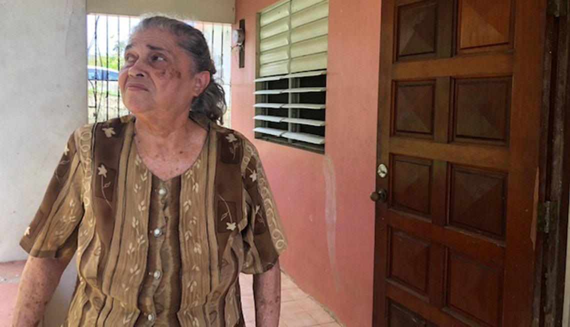 Hurricane survivor Nelida Castillo Cruz in front of her home