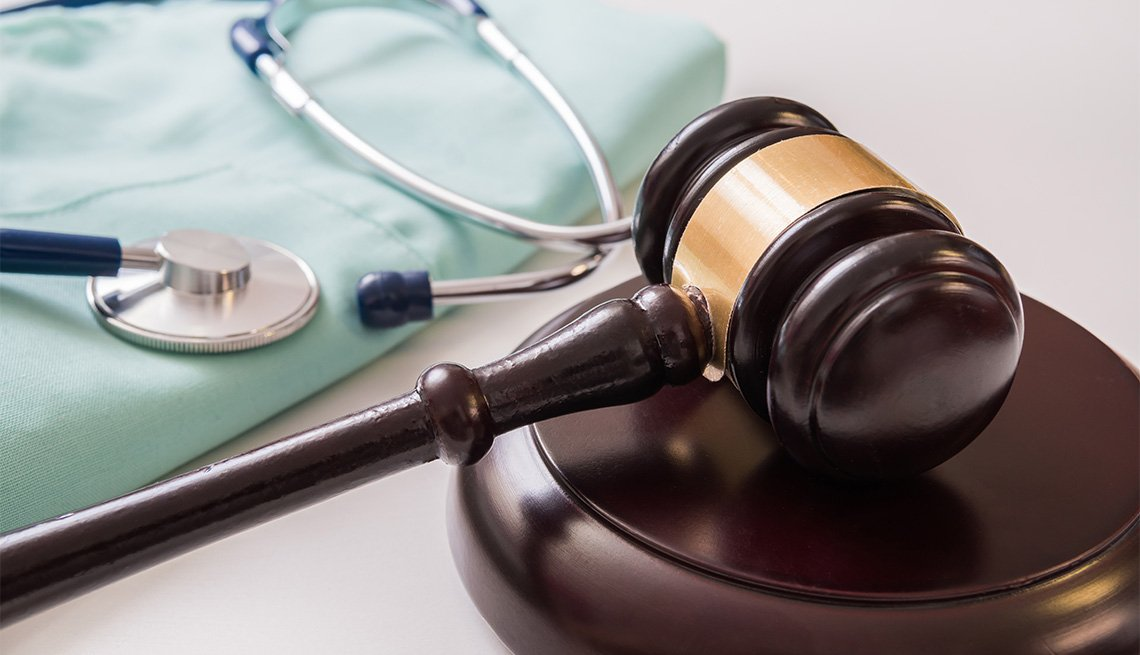 gavel with a stethoscope in the background