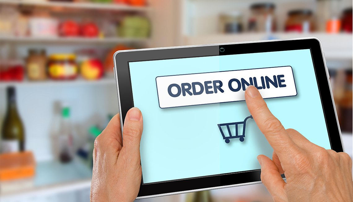 person using an tablet to start online grocery shopping