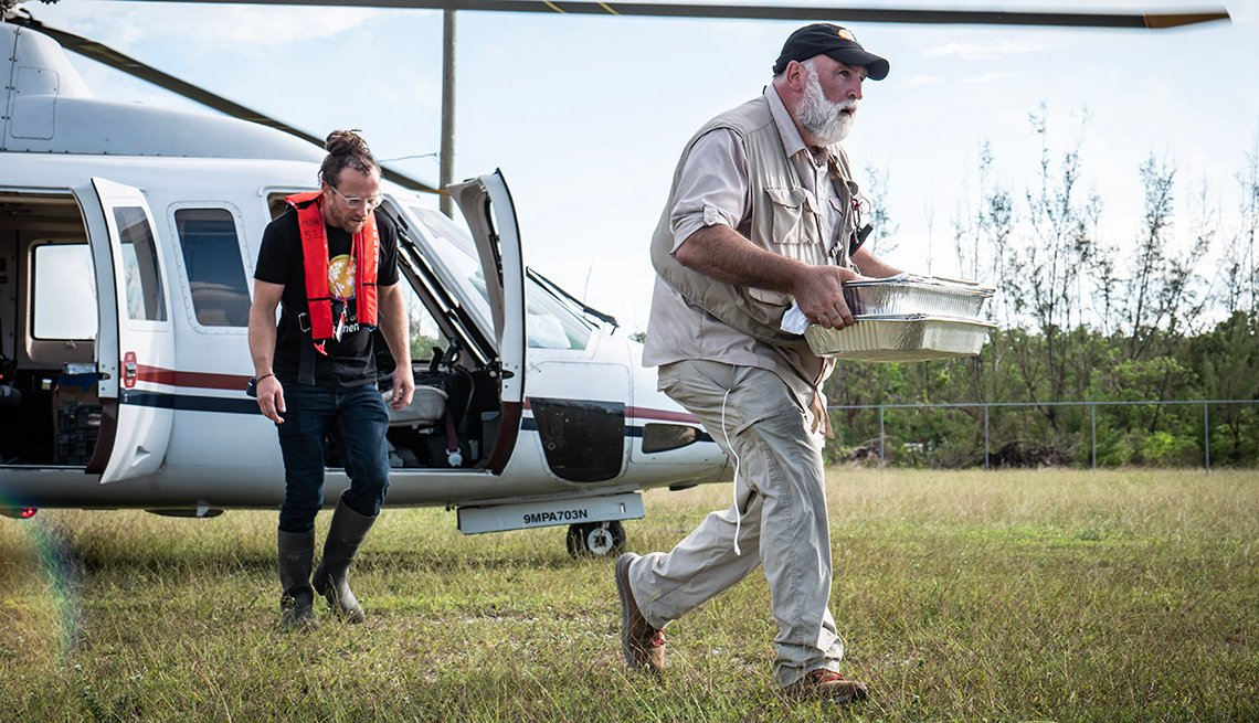 Jose Andres runs from a helicopter to deliver meals