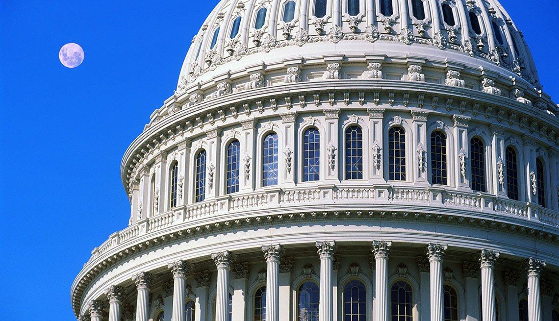 U.S. Capitol dome against a blue sky