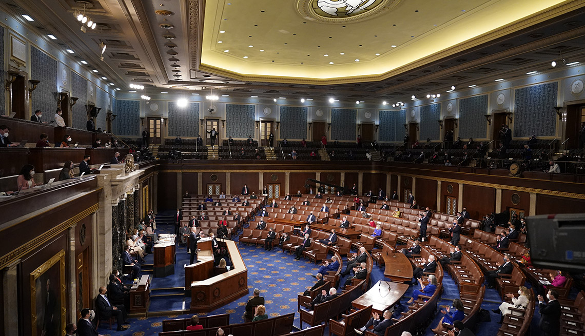 wide angle of President Joe Biden speaking to  sparse, socially distanced attendees at a joint session of Congress Wednesday, April 28, 2021, in the House Chamber at the U.S. Capitol in Washington