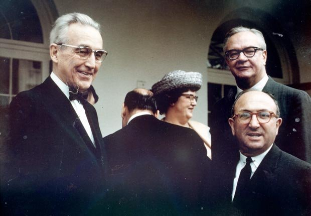Robert Ball, Wilbur Cohen, and Arthur Altmeyer meet at the White House in 1965