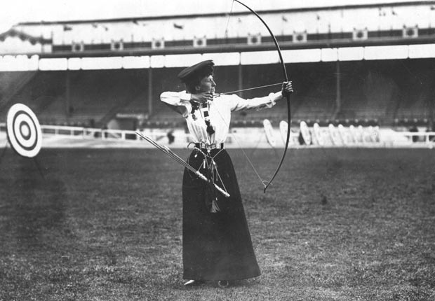 Queenie Newall positions herself to shoot an arrow with her bow