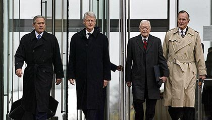 US President George W. Bush, and former US Presidents Bill Clinton, Jimmy Carter, and George Bush, are announced at the grand opening ceremony of the Clinton Presidential Center
