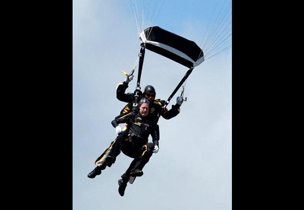 ormer President George H. W. Bush rides tandem with Army Sgt. Michael Elliott of the Army Golden Knights parachute team as he celebrates his 85th birthday with a parachute jump, Friday, June 12, 2009, in Kennebunkport, Maine.