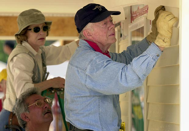 LAGRANGE, GA - JUNE 10:  Former U.S. President Jimmy Carter and his wife Rosalyn attach siding to the front of a Habitat for Humanity home being built June 10, 2003 in LaGrange, Georgia. More than 90 homes are being built in LaGrange; Valdosta, Georgia; and Anniston, Alabama by volunteers as part of Habitat for Humanity International's Jimmy Carter Work Project 2003.