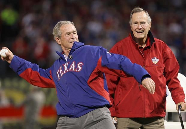 Former President of the United States, George W. Bush, throws out the first pitch as his father Former President George H.W. Bush looks on before the Texas Rangers host the San Francisco Giants in Game Four of the 2010 MLB World Series at Rangers Ballpark
