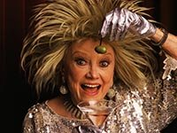 Comedienne Phyllis Diller holds olive and martini.  Diller died on August 20, 2012.
