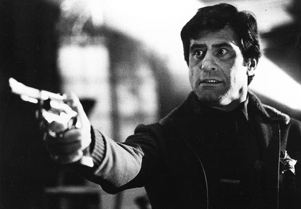 Actor James Farentino holds a gun in the movie Dead & Buried.  Farentino died on January 24, 2012.