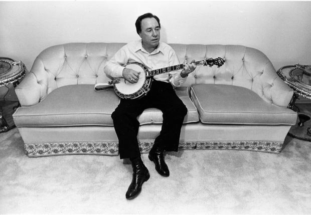 Bluegrass legend Earl Scruggs play banjo couch