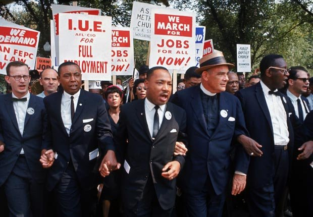 MLK jobs and freedom marching with signs