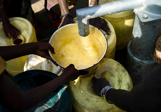 Water flows from a water pump into receiving hands, 10 effects of climate change