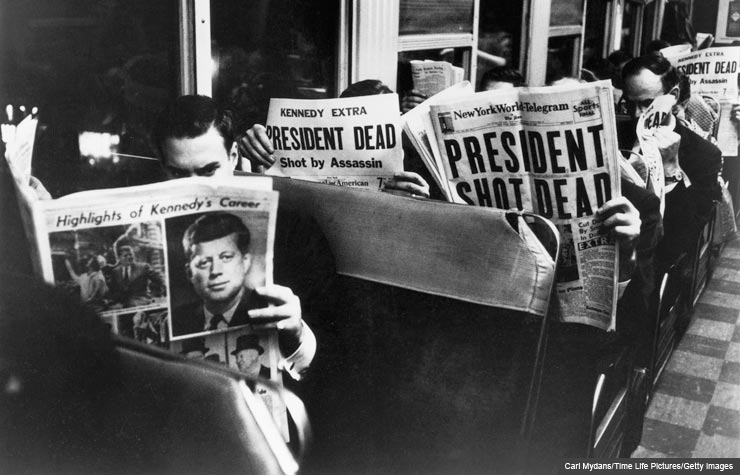 Commuters reading of John F. Kennedy's assassination, 22nd November 1963. (Carl Mydans/Time Life Pictures/Getty Images)