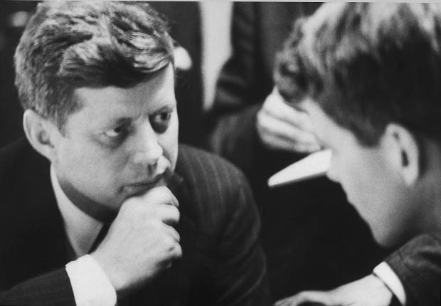Sen. John F. Kennedy (L) in campaign headquarters on primary election night with his brother Robert F. Kennedy (R).