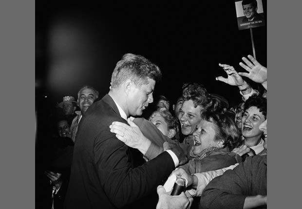 Senator John Kennedy received enthusiastic welcome during his campaigning.  Eager outstretched hands sought to touch the presidential candidate. Kennedy is shown as he was greeted in Denver.