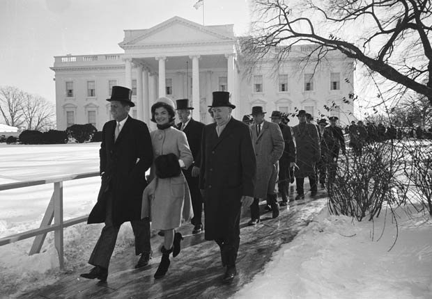 New President John F. Kennedy & wife Jacqueline Kennedy and others walking to his Inauguration.