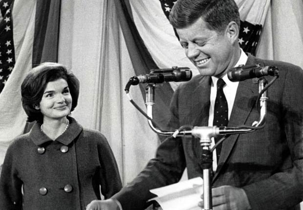 Massachusetts, USA, 9th November, 1960, Democrat President-elect of the United States of America John F, Kennedy smiles watched by his wife Jacqueline before speaking at Hyannis port Armory on the day his election victory was announced