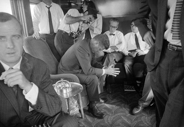 A weary Senator John F. Kennedy, Democratic presidential candidate, rests in his train car near the end of a 2-day railroad campaign in northern California.