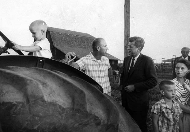 Senator John F. Kennedy (R) visiting a farm during campaign.