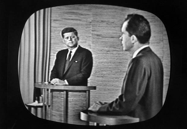 Presidential candidate Richard M. Nixon speaking during a televised debate while fellow candidate John F. Kennedy watches