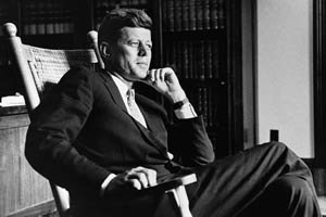 President John F. Kennedy (1917-1963), thirty-fifth president of the United States, relaxes in his trademark rocking chair in the Oval Office