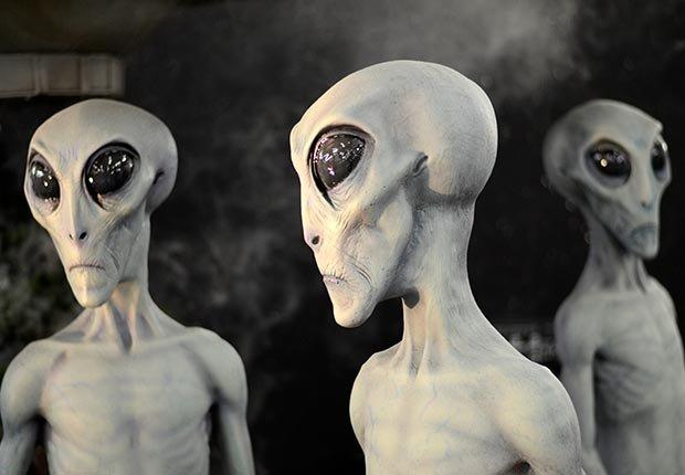 what we believe skeptical aliens ufo heaven hell zombies angels reincarnation ghosts astrology bigfoot apocalypse vampires poll stats belief alien heads (Corbis)