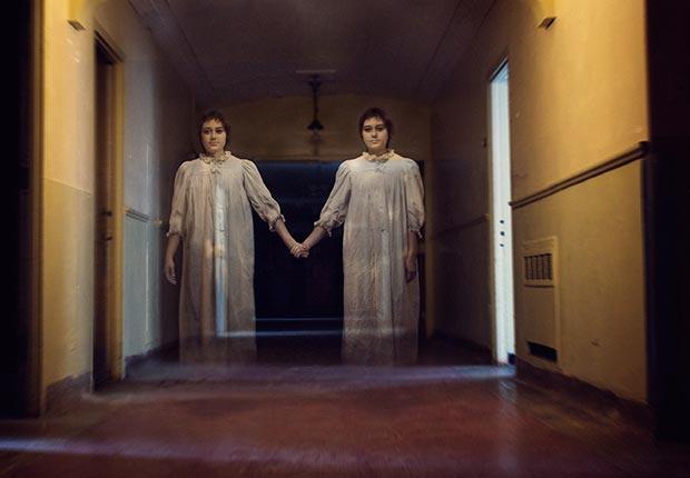 what we believe skeptical aliens ufo heaven hell zombies angels reincarnation ghosts astrology bigfoot apocalypse vampires poll stats belief ghost girls hallway (Flickr RM/Getty Images)
