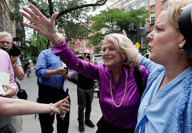 Edith Windsor, left, the plaintiff in the historic gay marriage case before the U.S. Supreme Court, accompanied by her attorney Robert Kaplan, arrives at the LGBT Center for a news conference, in New York, Wednesday, June 26, 2013. (AP)