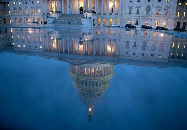 The U.S. Capitol is seen reflected in Washington, D.C. (Bloomberg/Getty Images)