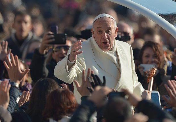 Pope Francis greets the crowd as he arrives for his general audience at St Peter's square. (AFP/Getty Images)