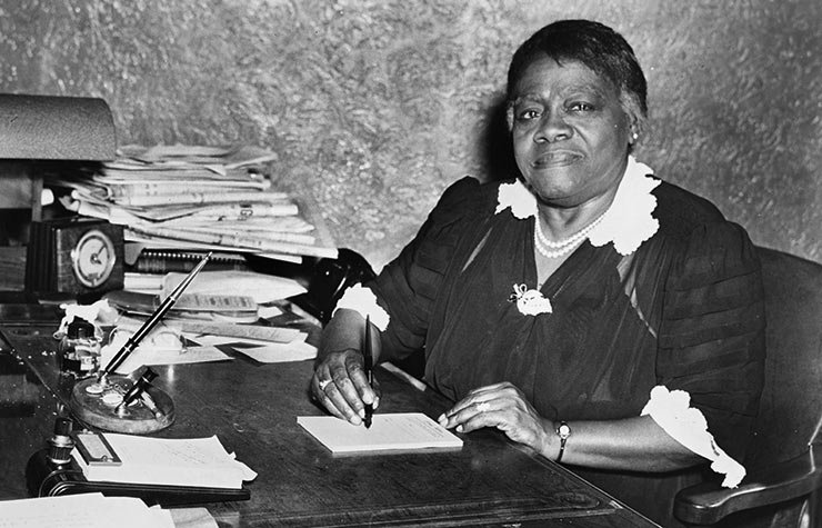 Educator Mary McLeod Bethune sits at a desk, possibly in the Chicago Defender offices in 1942, Historical Review of Leading Black Civil Rights Organizations