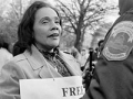 Coretta Scott King and delegate Walter Fauntroy of Washington, D.C. talk to a D.C. police officer while protesting outside the South African embassy in 1984.