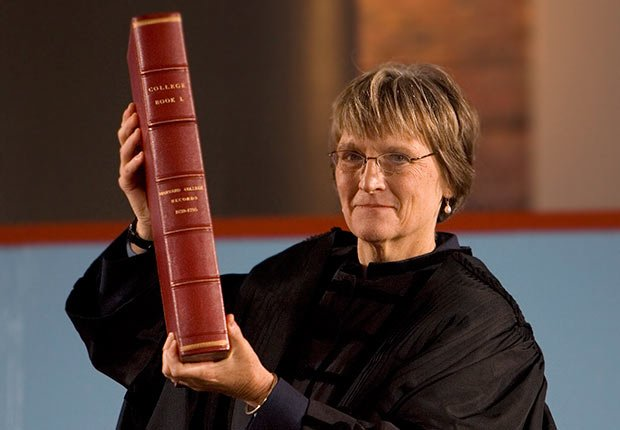 Drew Gilpin Faust holds the ceremonial college book, during her swearing-in as Harvard University's first woman president in Cambridge, Massachusetts