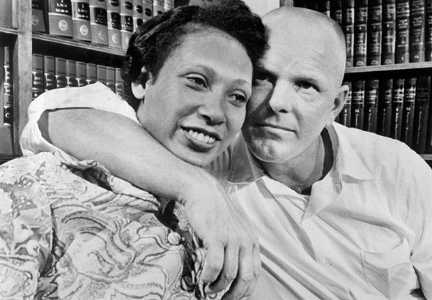 Mildred Loving and her husband, Richard Perry Loving, embrace on a couch, Women in the Civil Rights Movement
