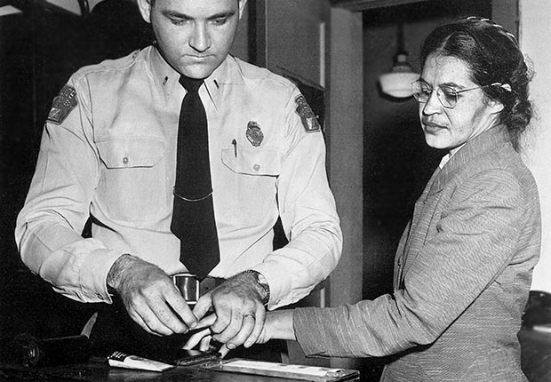 Rosa Parks, an Afro-American civil rights activist, has her fingerprints taken after her bus segregation protest in 1955