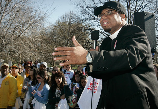 Rev. Lennox Yearwood, Jr., addresses survivors of Hurricane Katrina and their supporters as they demonstrate outside the White House after a march that started on Capitol Hill in Washington.