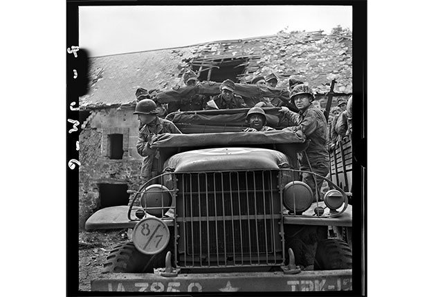 German prisoners transported by U.S. soldiers, near Saint-Lo, Manche, Normandy, July 27, 1944.