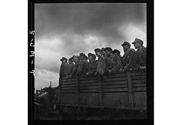 German prisoners taken away by U.S. soldiers, near St. Lo, Normandy, July 27,1944.