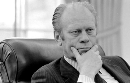 President Gerald R. Ford listens to a briefing by Secretary of State Henry A Kissinger on the situation in South Vietnam.