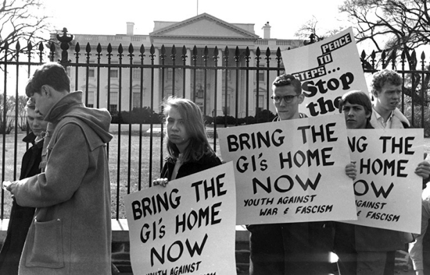 30th November 1965:  A few of the 20,000 protest marchers picketing the White House in Washington to demonstrate against American involvement in the Vietnam War. Their placards announce them to be representatives of Youth Against War & Fascism.